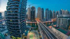 An Aerial view of Dubai Marina Towers in Dubai day to night timelapse. Aerial view of Dubai Marina Towers with yachts and traffic on bridge in Dubai day to night stock video
