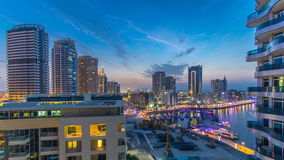 An Aerial view of Dubai Marina Towers in Dubai day to night timelapse stock video footage