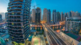 An Aerial view of Dubai Marina Towers in Dubai day to night timelapse stock footage