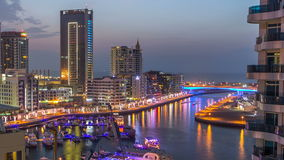An Aerial view of Dubai Marina Towers in Dubai day to night timelapse stock video