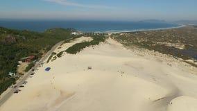 Aerial view Dunes in sunny day - Joaquina beach - Florianopolis - Santa Catarina - Brazil. July, 2017.  stock video footage