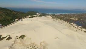 Aerial view dunes in sunny day - Joaquina beach - Florianopolis - Santa Catarina - Brazil. July, 2017.  stock video