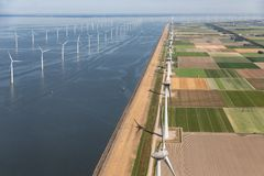Aerial view Dutch landscape with offshore wind turbines along coast royalty free stock image