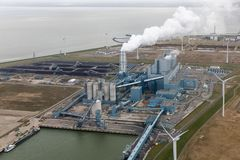 Aerial view Dutch Eemshaven with coal powered electricity plant. And coal storage area stock photography