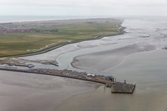 Aerial view Dutch island Ameland with pier and ferry terminal. Aerial view Dutch island Ameland with village and pier ferry terminal stock image