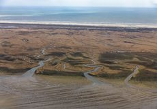 Aerial view Dutch island Schiermoniikoog, coastline with wetlands and channels. Aerial view Dutch island Schiermoniikoog, coastline with wetlands, mudflats and stock images
