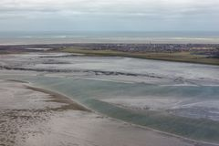 Aerial view Dutch island Schiermonnikoog with low tide at waddensea. Aerial view Dutch island Schiermonnikoog with lighthouse sand low tide at waddensea stock photo