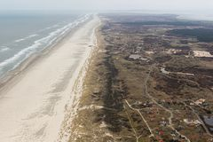 Aerial view Dutch island Terschelling with beach and holiday homes. Aerial view seaside Dutch island Terschelling with beach and holiday homes in the dunes royalty free stock image