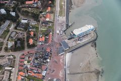 Aerial view Dutch island Vlieland with pier and ferry terminal royalty free stock image
