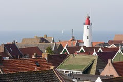 Aerial view at Dutch lighthouse and roofs Stock Photo