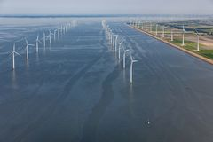 Aerial view Dutch sea with offshore wind turbines along coast royalty free stock photo