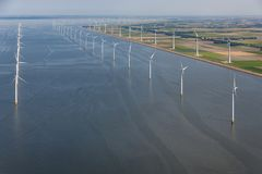 Aerial view Dutch sea with offshore wind turbines along coast royalty free stock photos