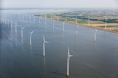Aerial view Dutch sea with offshore wind turbines along coast stock images