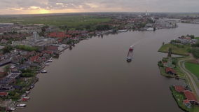 Aerial view of Dutch township and river stock video footage