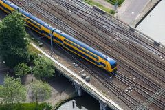 Aerial view of Dutch train crossing a bridge over a canal Stock Photos