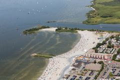 Aerial view Dutch village Makkum with beach and swimming people stock photos
