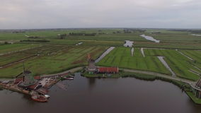 Aerial view of Dutch village with windmills stock footage