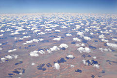 Aerial view of the earth with scattered clouds in blue sky Royalty Free Stock Photo