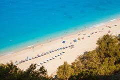 Aerial view of Egremni beach, Lefkada, Greece, on a sunny Summer day, with turquoise waters and beach umbrellas along the shore. Line. Unrecognizable people sun stock photography