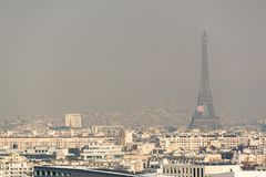 Aerial view of the Eiffel tower in the fog in Paris. City air pollution concept Stock Photography