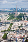 Aerial view of Eiffel tower and La. High-above morning view of the Eiffel tower and La Defense district behind stock photos