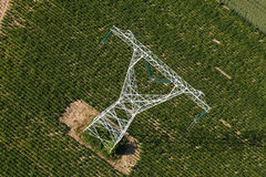 Aerial view of electrical wires large scale power energy tower Royalty Free Stock Images