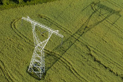 Aerial view of electrical wires large scale power energy tower Royalty Free Stock Photography
