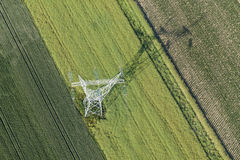 Aerial view of electrical wires large scale power energy tower Royalty Free Stock Photo