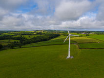 Aerial view of a electricity generating wind turbine. In green field stock photo