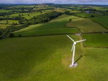 Aerial view of a electricity generating wind turbine. In green field royalty free stock images