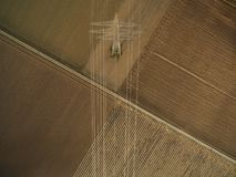 aerial view of electricity tower on agricultural fields, europe royalty free stock photography