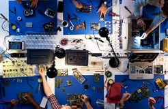 Aerial view of electronics technicians team working stock image