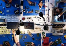 Aerial view of electronics technicians team working on computer Royalty Free Stock Image