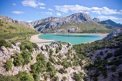 Aerial view of Embalse de Cuber, Mallorca, Spain. Aerial view of Embalse de Cuber outdoors in a valley with a water reservoir in the background Royalty Free Stock Photo