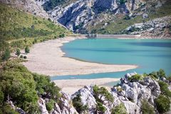 Aerial view of Embalse de Cuber, Mallorca, Spain. Aerial view of Embalse de Cuber outdoors in a valley with a water reservoir in the background Stock Image