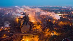 Aerial view. Emission to atmosphere from industrial pipes. Smokestack pipes shooted with drone. Night scene stock video footage