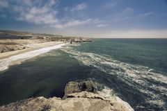 Aerial view of Empty Beach with steep cliffs Royalty Free Stock Image