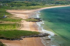 Panoramic view of unspoiled Portsalon beach, Donegal, Ireland. Aerial view of empty beach at Stocker Strand, Donegal Stock Images