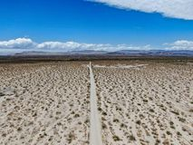 Aerial view of empty dirt road in the arid desert. stock images