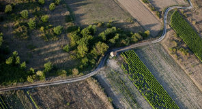 Aerial view of empty road and fields Royalty Free Stock Image
