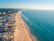 Aerial View Empty Sandy Beach with Small Waves Stock Images