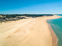 Aerial View Empty Sandy Beach with Small Waves Stock Photos