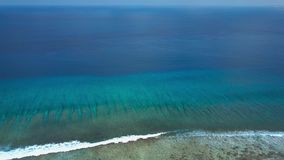 Aerial view of endless turquoise azure indian ocean swash and surfing waves stock footage