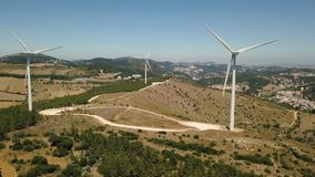 Aerial view of energy producing wind turbines, Portugal stock video