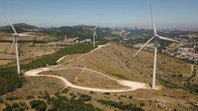Aerial view of energy producing wind turbines, Portugal stock video footage