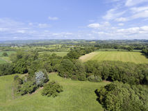 Aerial view of english country, with farms, meadows, woods . Stock Images
