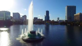 Aerial view of Eola Lake fountain at Orlando downtown, Florida. Orlando, Florida, USA - DEC, 2016: Aerial view Eola Lake fountain at Orlando downtown, Florida stock footage