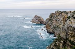 Aerial view of the epic cliffs in Cabo de Peñas in Asturias, Spa. Aerial view of the epic cliffs in Cabo de Peñas in Asturias, Spain. Dramatic fall Royalty Free Stock Photography