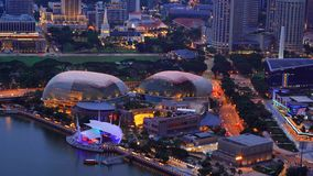 Aerial view of Esplanade Theatre outdoor, Downtown Singapore city in Marina Bay area. Financial district and skyscraper buildings. At night royalty free stock photos