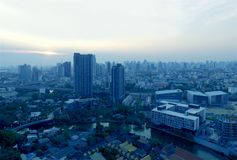 Aerial view the evening of Bangkok`s suburban in mystique blue color by drone royalty free stock images